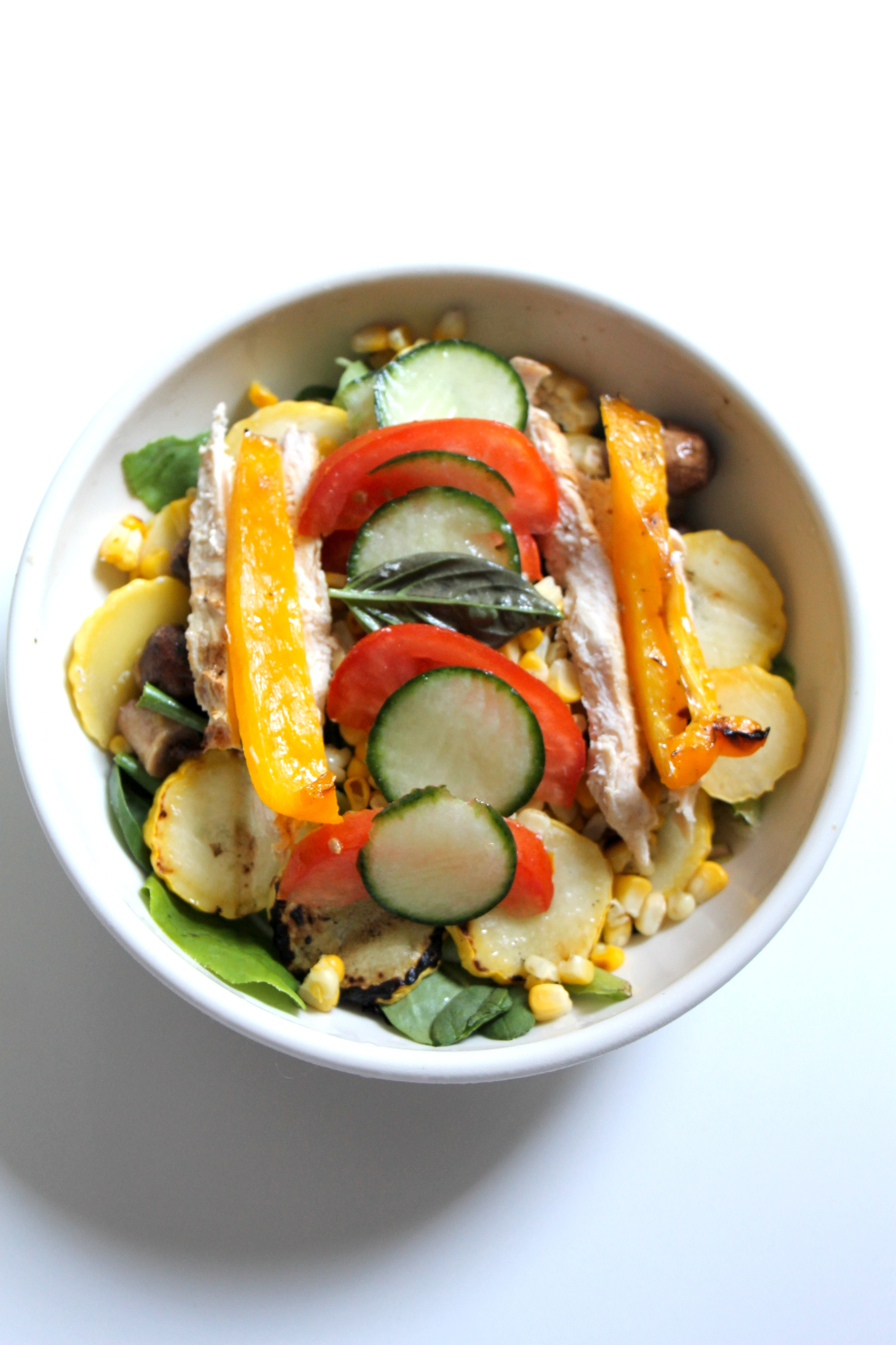 A combination of grilled vegetables and toppings chosen for color, texture and taste compose a first rate salad.