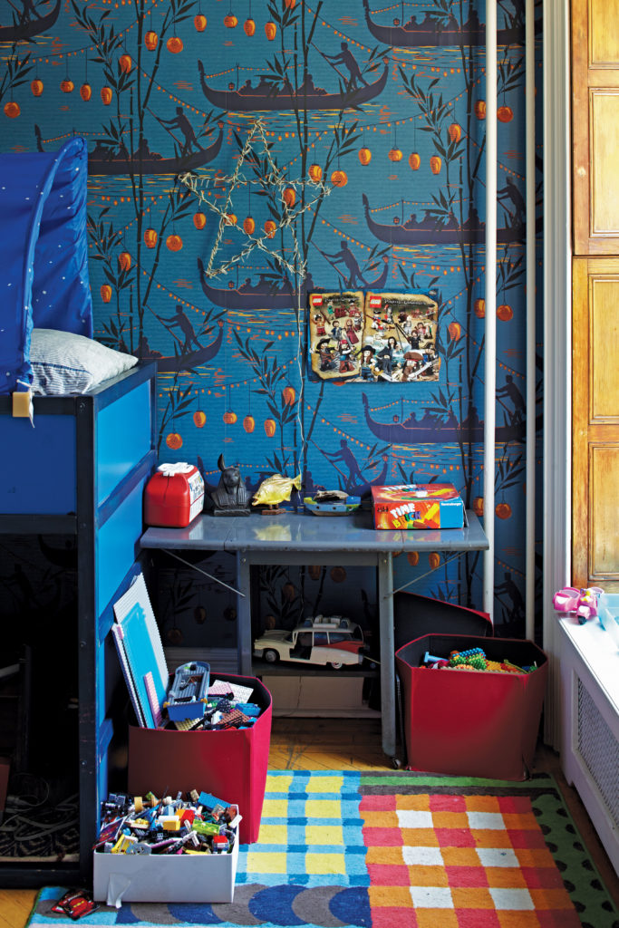 boy's room designed with an attention to colors, wallpaper and fine pieces, copyright by David A. Land.