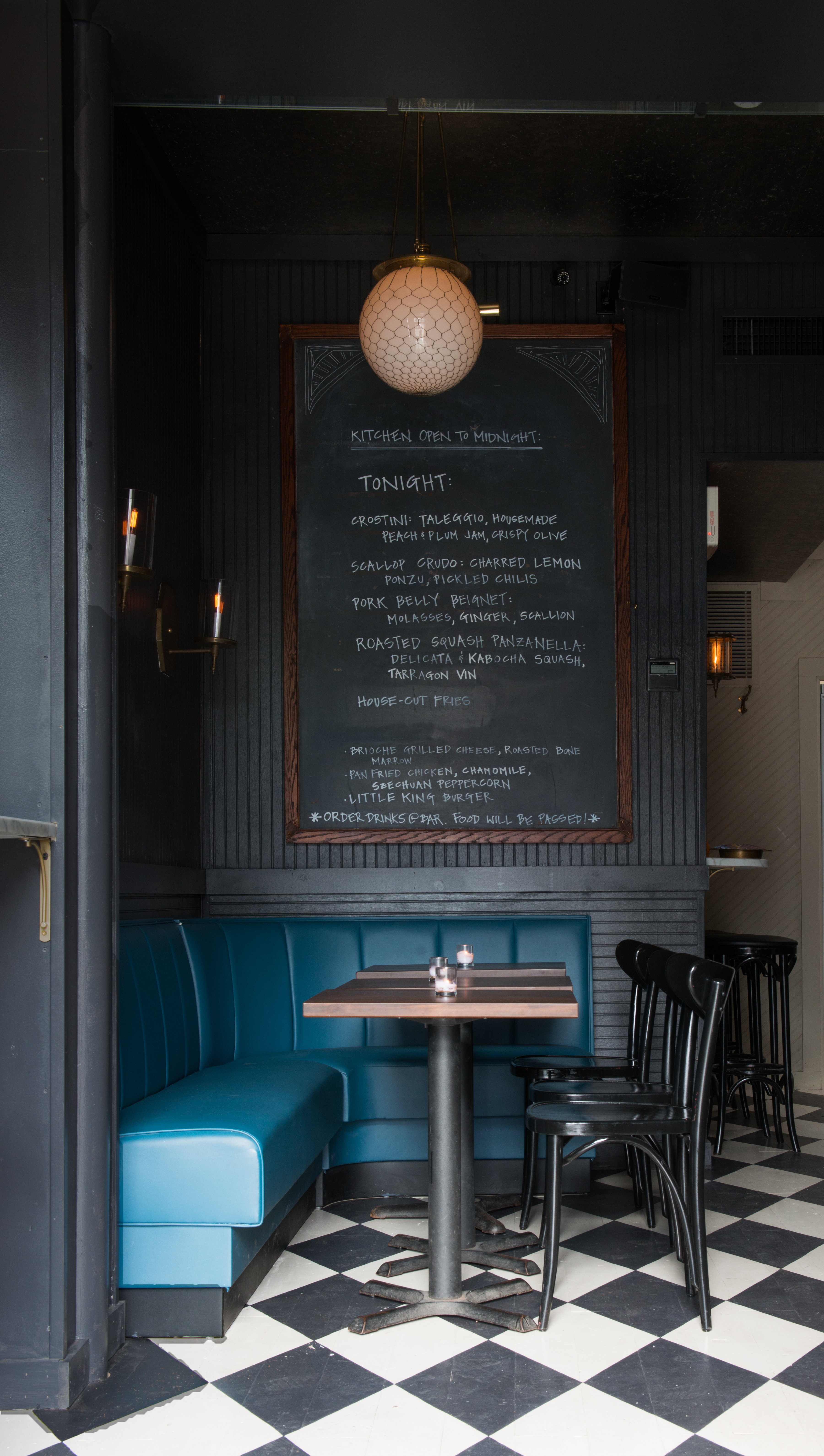 Neighborhood atmosphere achieved via a smoky color palette, touches of blue, and vintage details.